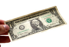 Hand die één dollarrekening houdt Stock Foto's