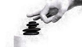 Hand, die über Steinen klopft Stockfoto