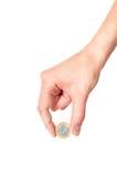 Hand, die 1 Euromünze anhält Stockfotos
