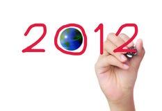 Hand, die 2012 schreibt Stockbild