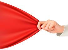 Hand die aan een rode doek met ruimte voor tekst trekken Royalty-vrije Stock Fotografie