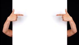 Hand die aan witte muur richt Royalty-vrije Stock Afbeeldingen