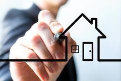 Hand, die abstraktes Haus zeichnet Lizenzfreie Stockfotos