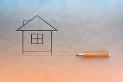 Hand, die abstraktes Haus zeichnet Stockfotografie