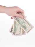 Hand die Amerikaanse dollars houdt royalty-vrije stock afbeeldingen