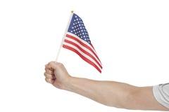 Hand, die amerikanische Flagge auf Weiß hält Lizenzfreies Stockfoto