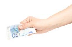 Hand, die Anmerkung des Euros zwanzig hält Stockfotos