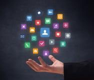 Hand, die Anwendungen hält lizenzfreies stockfoto