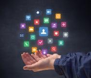 Hand, die Anwendungen hält lizenzfreie stockbilder
