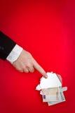 Hand, die auf Geld zeigt Lizenzfreie Stockfotos