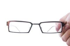 Hand, die Augengläser hält lizenzfreie stockfotos