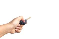 Hand, die Autoschlüssel hält Stockfoto