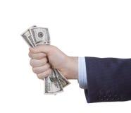 Hand, die Bündel des Dollars zusammendrückt Lizenzfreie Stockfotografie