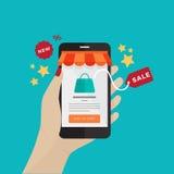 Hand, die beweglichen Einkaufsm-handel Smartphones hält Stockfotografie