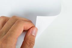 Hand die Blanco pagina draait Royalty-vrije Stock Afbeeldingen