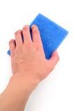 Hand, die blauen Wäscher anhält Lizenzfreie Stockbilder