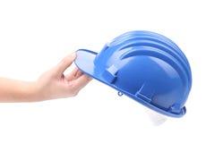 Hand die blauwe bouwvakker houden stock fotografie