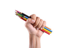 Hand, die Bleistiftfarben lokalisiert hält Stockfotografie