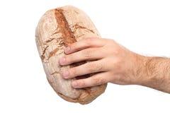 Hand, die Brot hält Stockfoto