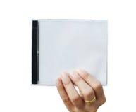 Hand, die CD Abdeckung anhält Stockfotografie