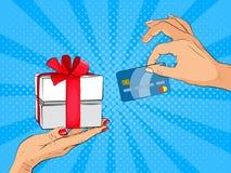 Hand die creditcard en huidige gift in plaats daarvan in pop-artstijl geven Royalty-vrije Stock Afbeelding