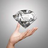 Hand die 3d diamant houden Stock Fotografie