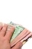Hand, die das Versteck von kanadischen Banknoten versteckt lizenzfreie stockbilder