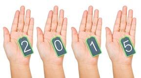 Hand die de lege houten die markering van 2015 houden op witte achtergrond wordt geïsoleerd Royalty-vrije Stock Fotografie
