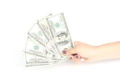 Hand, die 100 Dollar auf Weiß hält Stockbild