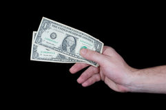 Hand, die Dollarbanknoten gibt Stockfotografie