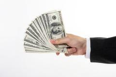 Hand die dollars houdt Royalty-vrije Stock Foto's