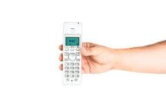 Hand, die drahtloses Haupttelefon hält lizenzfreie stockbilder