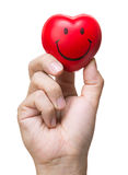 Hand, die Druckball in der Herzform zusammendrückt Stockbild