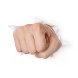 Hand, die durch Papier locht Stockfotos