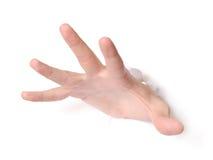 Hand, die durch Papier locht lizenzfreie stockbilder