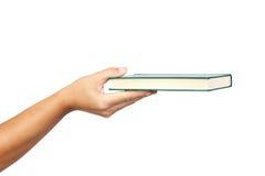 Hand die een boek aanbiedt stock fotografie