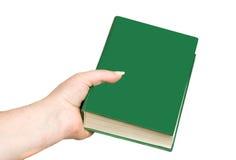 Hand die een boek houdt Stock Afbeelding