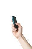 Hand die een celtelefoon geïsoleerde houdt Royalty-vrije Stock Foto's