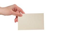 Hand die een document kaart houdt stock afbeelding