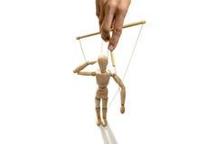 Hand die een geïsoleerde marionet manipuleren, Stock Afbeelding