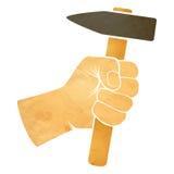 Hand die een hamer houden Stock Foto