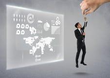 Hand die een mens met een kabel op een grijze achtergrond met grafiek kiezen royalty-vrije stock foto