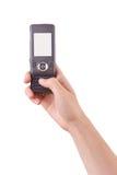 Hand die een mobiele telefoon houdt Stock Foto