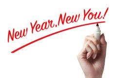 Hand die een pen houden en nieuw nieuw jaar schrijven u Stock Afbeeldingen