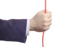 Hand die een rood koord houdt stock afbeelding