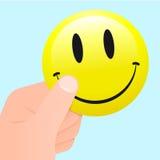 Hand die een smileygezicht houdt Royalty-vrije Stock Foto