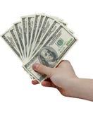 Hand die een stapel van contant geld houden Royalty-vrije Stock Foto's