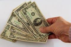 Hand die een ventilator van dollars houden royalty-vrije stock foto's