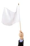 Hand die een witte vlag golft Stock Afbeelding
