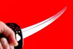 Hand die een zwaard houdt royalty-vrije stock fotografie